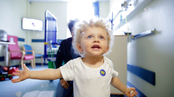 child in hospital chasing bubbles