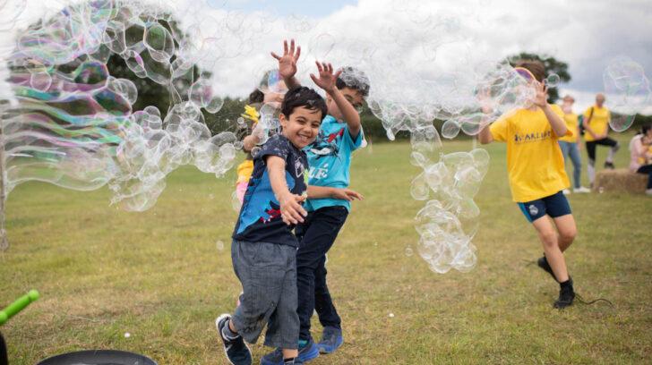 Children with bubbles at the Starlight Popham Escape